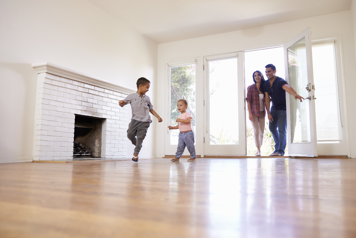 A family with two children entering a new home
