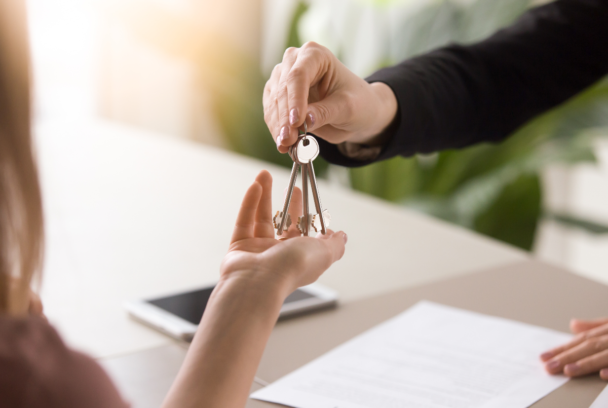 Woman being handed a set of house keys