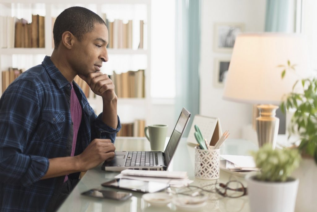 Home buyer using laptop to send lender his mortgage application