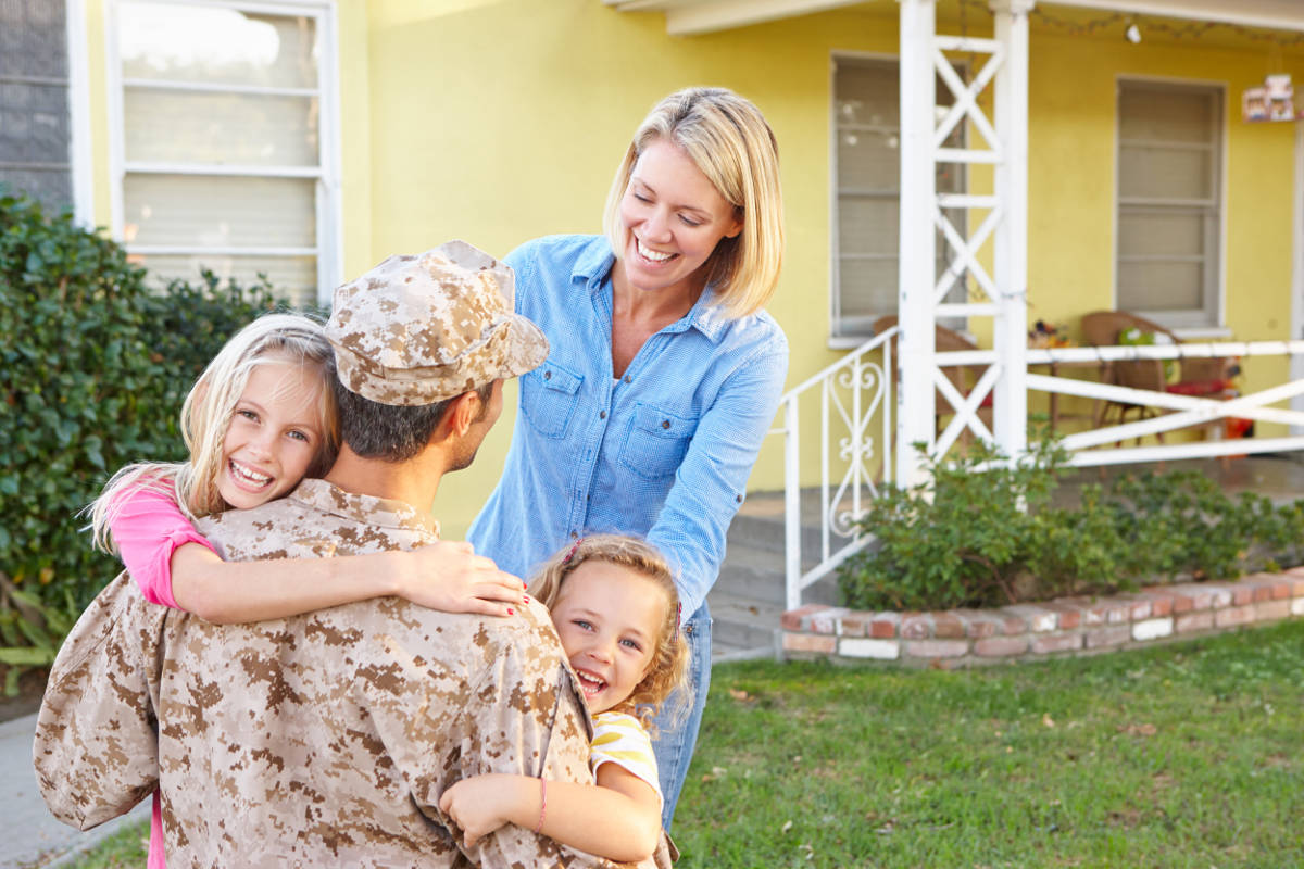Armed Forces Family hugging